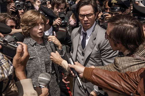 A desperate Gail (Michelle Williams) pleads with the kidnappers to set her son free while being escorted to her car by Fletcher Chace (Mark Wahlberg) in TriStar Pictures' ALL THE MONEY IN THE WORLD. Photo Credit: Fabio Lovino, ©2017 ALL THE MONEY US, LLC. ALL RIGHTS RESERVED.