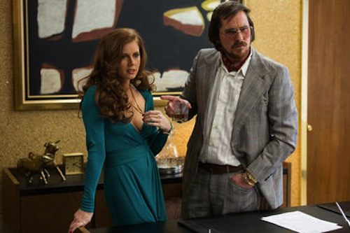 AAmy Adams as Sydney Prosser and Christian Bale as Irving Rosenfeld in American Hustle.