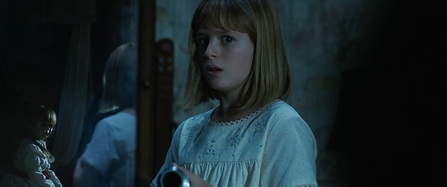 (L-R) The Annabelle doll and LULU WILSON as Linda in New Line Cinema's supernatural thriller ANNABELLE: CREATION, a Warner Bros. Pictures release. Courtesy of Warner Bros. Pictures, © 2017 WARNER BROS. ENTERTAINMENT INC. AND RATPAC-DUNE ENTERTAINMENT LLC.