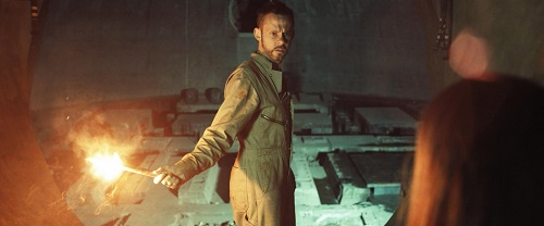 Dominic Monaghan as Robinson in the sci-fi thriller film