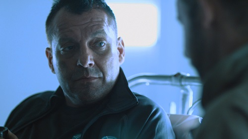 Tom Sizemore as Zek in the sci-fi thriller film