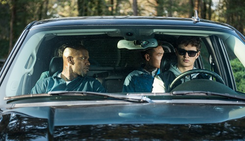 Baby (ANSEL ELGORT, front right), Bats (JAMIE FOXX, front left), JD (LANNY JOON, back right), Eddie (FLEA BALZARY, back left) wait in the car in TriStar Pictures' BABY DRIVER. Sony Pictures Entertainment 2017, All Rights Reserved.