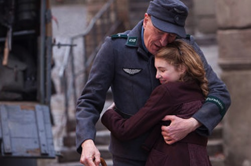 Sophie Nelisse as Liesel and Geoffrey Rush as Hans in The Book Thief. 2013 Jules Heath / Twentieth Century Fox.