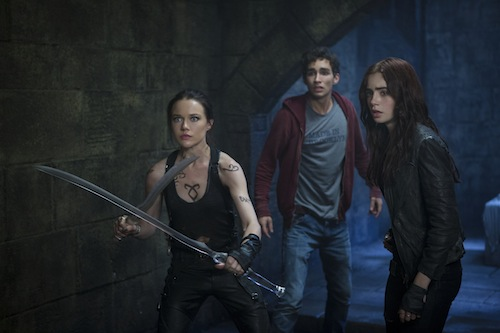 Isabelle Lightwood (Jemima West), Simon (Robert Sheehan) and Clary (Lily Collins) prepare to hold off the demons in Screen Gems THE MORTAL INSTRUMENTS: CITY OF BONES. PHOTO BY:	Rafy COPYRIGHT:	2013 Constantin Film International GmbH and Unique Features (TMI) Inc. All rights reserved. ALL IMAGES ARE PROPERTY OF SONY PICTURES ENTERTAINMENT INC. FOR PROMOTIONAL USE ONLY. SALE, DUPLICATION OR TRANSFER OF THIS MATERIAL IS STRICTLY PROHIBITED.