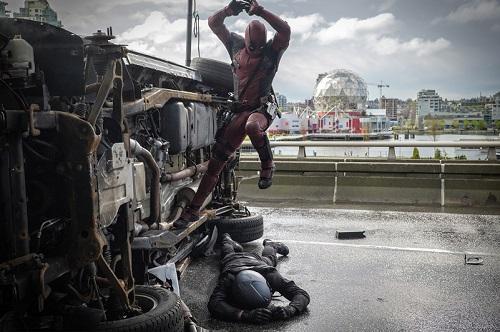 Deadpool (Ryan Reynolds) pounces on an adversary. Photo credit: Joe Lederer, 2015 Marvel and 20th Century Fox Film Corporation.