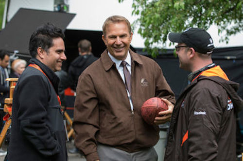 Rajiv Joseph, Kevin Costner and Scott Rothman on the set of Draft Day. 2014 Summit Entertainment.