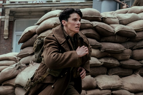 FIONN WHITEHEAD as Tommy in the Warner Bros. Pictures action thriller DUNKIRK, a Warner Bros. Pictures release. Photo credit: Melinda Sue Gordon.