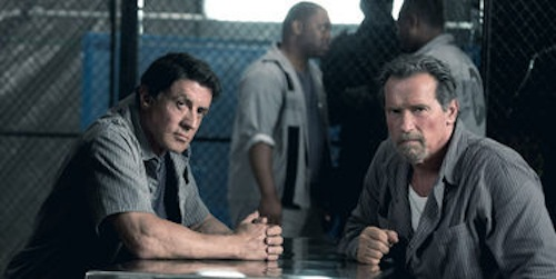 Sylvester Stallone and Arnold Schwarzenegger in Escape Plan. 2013 Summit Entertainment.
