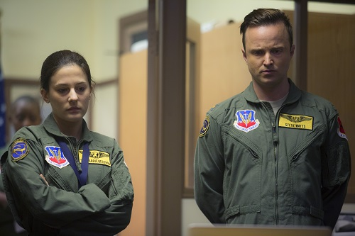 Phoebe Fox (left) stars as Carrie Gershon and Aaron Paul (right) stars as Steve Watts in Gavin Hood's EYE IN THE SKY, a Bleecker Street release. Credit: Keith Bernstein / Bleecker Street