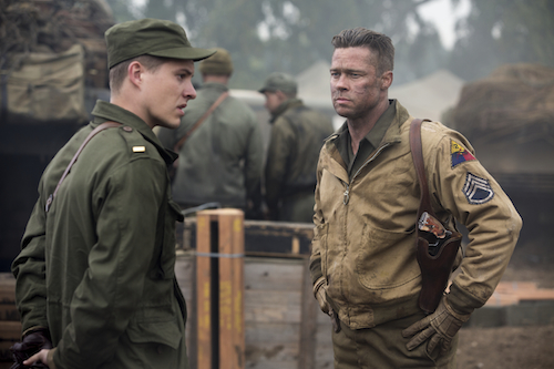 Wardaddy (Brad Pitt) gets his new orders from Lieutenant Parker (Xavier Samuel) in Columbia Pictures' FURY. Photo Credit: Giles Keyte. 2014 CTMG, Inc. All Rights Reserved. ALL IMAGES ARE PROPERTY OF SONY PICTURES ENTERTAINMENT INC. FOR PROMOTIONAL USE ONLY.