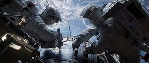 Sandra Bullock as Dr. Ryan Stone and George Clooney as Matt Kowalsky in Gravity. 2013 Warner Bros.