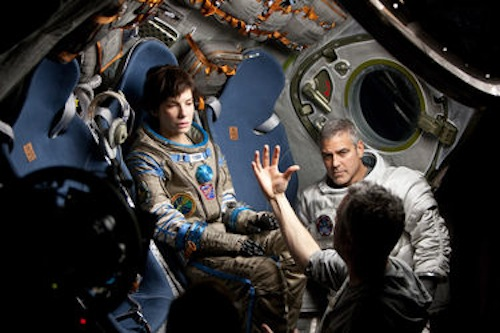 Sandra Bullock, George Clooney and Director Alfonso Cuaron on the set of Gravity. 2013 Murdo Macleod / Warner Bros