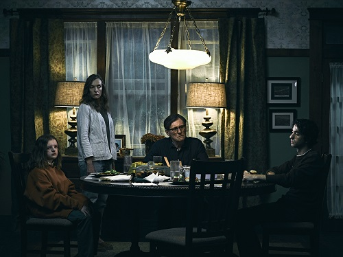 Milly Shapiro, Toni Collette, Gabriel Byrne, and Alex Wolff in Hereditary, photo by James Minchin, courtesy of A24.