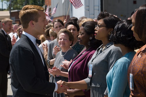 Katherine G. Johnson (Taraji P. Henson), flanked by fellow mathematicians Dorothy Vaughan (Octavia Spencer) and Mary Jackson (Janelle Monáe) meet the man they helped send into orbit, John Glenn (Glen Powell), in HIDDEN FIGURES. Photo Credit: Hopper Stone, 2016 Twentieth Century Fox Film Corporation. All Rights Reserved.