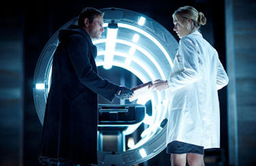 Aaron Eckhart as Adam and Yvonne Strahovski as Terra in I, Frankenstein.2014 Ben King / Lionsgate Films