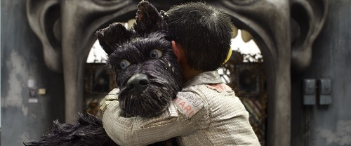 Bryan Cranston as Chief and Koyu Rankin as Atari Kobayashi in the film ISLE OF DOGS. Photo Courtesy of Fox Searchlight Pictures. © 2018 Twentieth Century Fox Film Corporation All Rights Reserved.