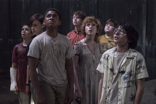 (l-r) JACK DYLAN GRAZER as Eddie Kaspbrak, JAEDEN LIEBERHER as Bill Denbrough, CHOSEN JACOBS as Mike Hanlon, WYATT OLEFF as Stanley Uris, SOPHIA LILLIS as Beverly Marsh, JEREMY RAY TAYLOR as Ben Hanscom and FINN WOLFHARD as Richie Tozier in New Line Cinema's horror thriller IT, a Warner Bros. Pictures release. Photo by Brooke Palmer, © 2017 WARNER BROS. ENTERTAINMENT INC. AND RATPAC-DUNE ENTERTAINMENT LLC.  ALL RIGHTS RESERVED.