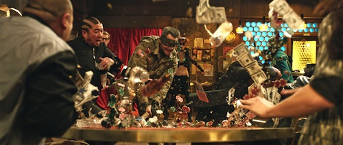 Colonel Stars and Stripes (JIM CARREY) leads Justice Forever in a vigilante raid in the follow-up to 2010's irreverent global hit Kick-Ass 2. Photo Credit: Daniel Smith Copyright: © 2013 Universal Studios. ALL RIGHTS RESERVED.
