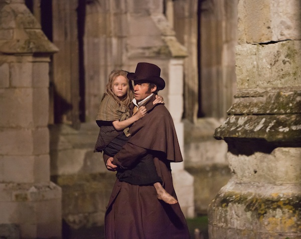 ISABELLE ALLEN as young Cosette and HUGH JACKMAN as Jean Valjean in