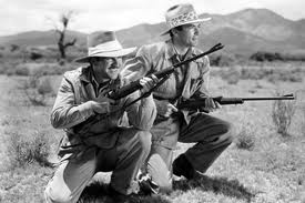 Gregory Peck and Robert Preston in The Macomber Affair