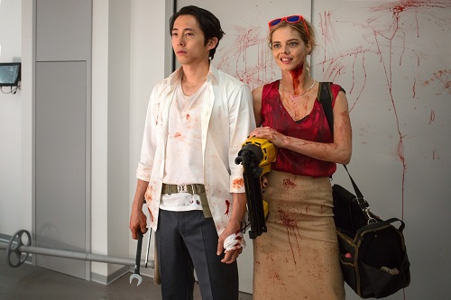 (L-R) Steven Yeun as Derek Cho and Samara Weaving as Melanie Cross in the horror, action film MAYHEM, an RLJE Films release. Photo courtesy of Sanja Bucko.