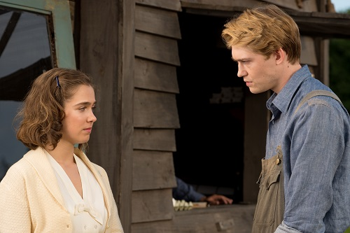 Haley Lu Richardson (left) stars as Sylvia Hermann and Joe Alwyn (right) stars as Klaus Eichmann in OPERATION FINALE, written by Matthew Orton and directed by Chris Weitz, a Metro Goldwyn Mayer Pictures film. Credit:  Valeria Florini / Metro Goldwyn Mayer Pictures © 2018 Metro-Goldwyn-Mayer Pictures Inc. All Rights Reserved.