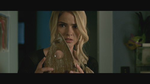 SHELLEY HENNIG stars as Debbie in Ouija, a supernatural thriller about a group of friends who must confront their most terrifying fears when they awaken the dark powers of an ancient spirit board. Photo Credit: Matt Kennedy/Universal Pictures Copyright: 2014 Universal Studios. ALL RIGHTS RESERVED.