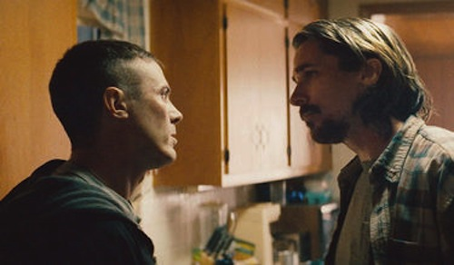 WCasey Affleck and Christian Bale in Out of the Furnace. 2013 Relativity Media.