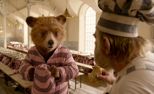 (L-R) Paddington voiced by BEN WHISHAW and BRENDAN GLEESON as Knuckles McGinty in the family adventure PADDINGTON 2 from Warner Bros. Pictures and STUDIOCANAL, in association with Anton Capital Entertainment S.C.A., a Warner Bros. Pictures release. Photo Courtesy of Warner Bros. Pictures.