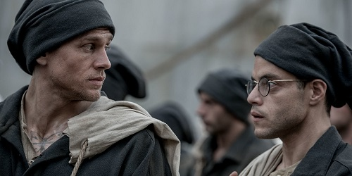 Charlie Hunnam (left) stars as Henri 'Papillon' Charriére and Rami Malek (right) stars as Louis Dega and in director Michael Noer's PAPILLON, a Bleecker Street release. Credit: Jose Haro / Bleecker Street.
