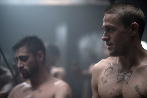 Charlie Hunnam (right) stars as Henri 'Papillon' Charriére in director Michael Noer's PAPILLON, a Bleecker Street release. Credit: Jose Haro / Bleecker Street.