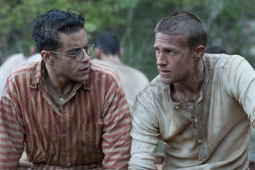 Rami Malek (left) stars as Louis Dega and Charlie Hunnam (right) stars as Henri 'Papillon' Charriére in director Michael Noer's PAPILLON, a Bleecker Street release. Credit: Jose Haro / Bleecker Street.