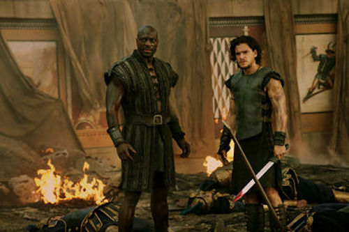 Adewele Akinnouye-Agbaje as Atticus and Kit Harington as Milo in Pompeii. 2014 George Kraychyk / Sony Pictures.
