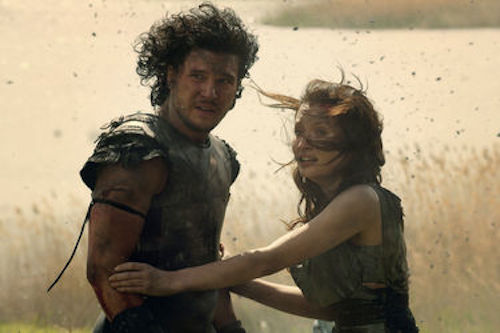 Kit Harington as Milo and Emily Browning as Cassia in Pompeii. 2014 Caitlin Cronenberg / Sony Pictures.