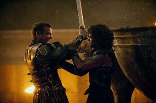 Kit Harington as Milo and Kiefer Sutherland as Corvus in Pompeii. 2014 George Kraychyk / Sony Pictures.