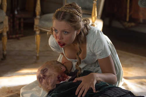 Annabelle (Jess Radomska) chewing her grandfather in Screen Gems' PRIDE AND PREJUDICE AND ZOMBIES. Copyright 2015 CTMG, Inc. All Rights Reserved.