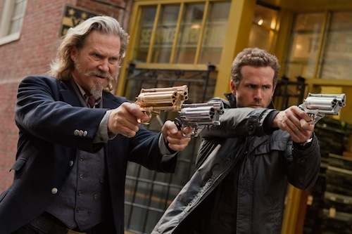 JEFF BRIDGES and RYAN REYNOLDS headline the 3D supernatural action-adventure R.I.P.D. as two cops dispatched by the otherworldly Rest In Peace Department to protect and serve the living from an increasingly destructive array of creatures who refuse to move peacefully into the afterlife. Photo Credit: Scott Garfield. Copyright: 2013 Universal Studios. ALL RIGHTS RESERVED.