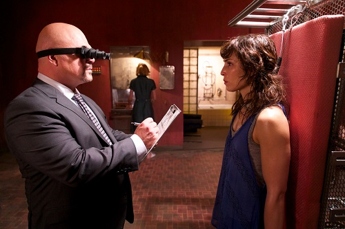 (L-R) Michael Chiklis as Bald Man and Noomi Rapace as Renee in the sci-fi thriller