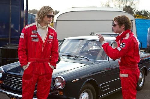 (L to R) CHRIS HEMSWORTH as the charismatic Englishman James Hunt and DANIEL BRÜHL as disciplined Austrian perfectionist Niki Lauda in Rush, two-time Academy Award winner Ron Howard's spectacular big-screen re-creation of the merciless 1970s Grand Prix rivalry between Hunt and Lauda. Photo Credit: Jaap Buitendijk. 2013 Universal Studios. ALL RIGHTS RESERVED.