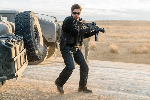 Alejandro (Benicio Del Toro) opens fire on the Mexican police ambushing the humvee convoy. Photo Credit: Richard Foreman, Jr. SMPSP.