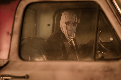 Man in the Mask (Damian Maffei) stalks his unsuspecting victims in THE STRANGERS: PREY AT NIGHT. Photo credit: Brian Douglas / Aviron Pictures.