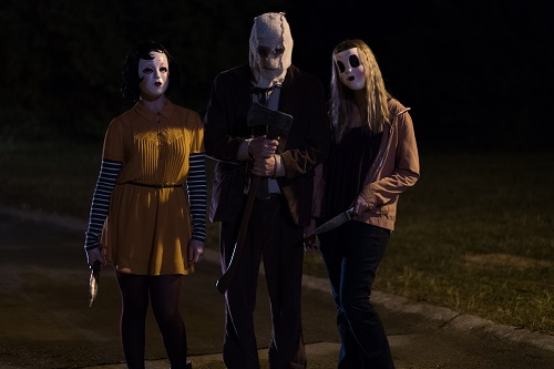 Pinup (Anna Shaffer), Man in the Mask (Damian Maffei) and Dollface (Emma Bellomy) are on the hunt for a killer night in THE STRANGERS: PREY AT NIGHT. Photo credit: Brian Douglas / Aviron Pictures.