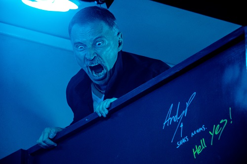 Begbie (Robert Carlyle) raging over toilet cubicle in TriStar Pictures T2: TRAINSPOTTING