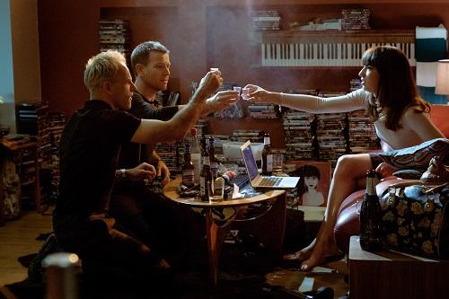 Simon (Jonny Lee Miller), Renton (Ewan McGregor) and Veronika (Anjela Nedyalkova) drinking in Simon's flat in TriStar Pictures' T2 TRAINSPOTTING.