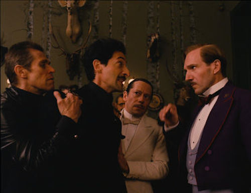 Willem Dafoe as Jopling, Adrien Brody as Dmitri, Mathieu Almaric as Serge and Ralph Fiennes as M. Gustave in The Grand Budapest Hotel. 2014 Fox Seachlight Pictures.
