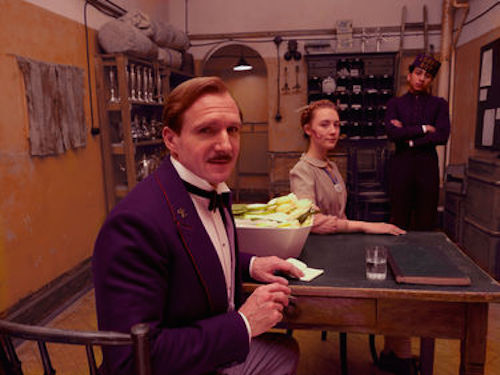 Ralph Fiennes as M. Gustave, Saoirse Ronan as Agatha and Tony Revolori as Zero in The Grand Budapest Hotel. 2014 Fox Seachlight Pictures.