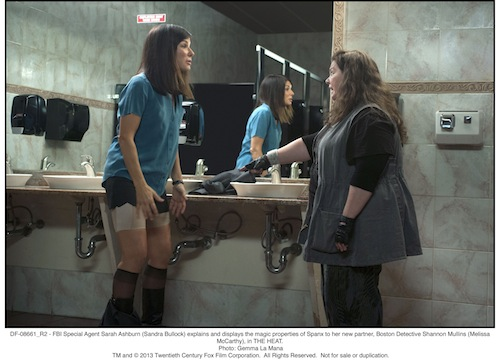 FBI Special Agent Sarah Ashburn (Sandra Bullock) explains and displays the magic properties of Spanx to her new partner, Boston Detective Shannon Mullins (Melissa McCarthy), in THE HEAT. Photo: Gemma La Mana - TM & 2013 Twentieth Century Fox Film Corporation. All Rights Reserved.