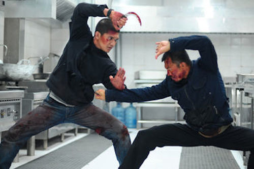 Iko Uwais as Rama and Cecep Arif Rahman as The Assassin in The Raid 2. 2014 Sony Pictures Classics.