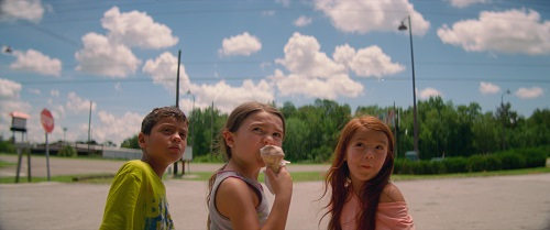 Christopher Rivera, Brooklynn Prince, and Valeria Cotto in The Florida Project. Photo courtesy cf A24.
