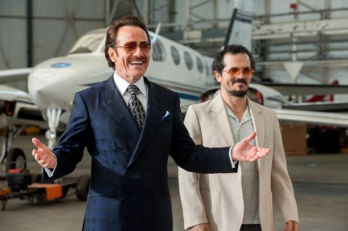 (l to r) Bryan Cranston stars as undercover U.S. Customs agent Robert Mazur and John Leguizamo as his partner Emir Abreu in THE INFILTRATOR, a Broad Green Pictures release.